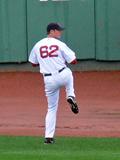 Jon Lester warms up after the rain